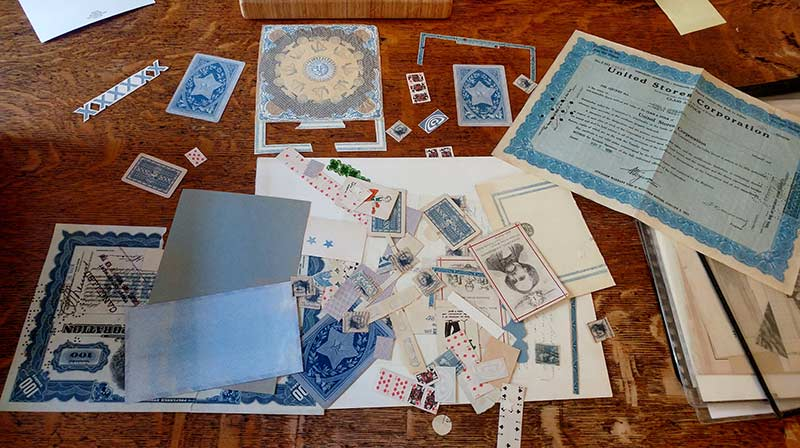 Blue fragments laid out on Ron Padgett's table